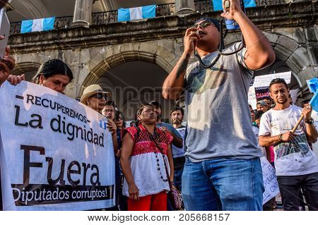 Antigua Guatemala - September 15 2017: Locals protest against government corruption in front of city hall on Guatemala's Independence Day.