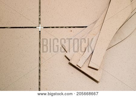 Tiling, Tile Trimming, Metering And Cutting. Repair Of The Floor. Sliced Gres Tiles.
