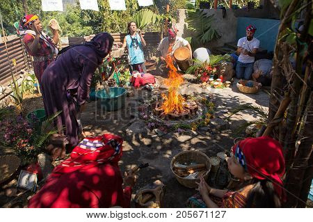 January 31, 2015 San Pedro La Laguna, Guatemala: People Gathering Around A Fire Set Of Candles And P