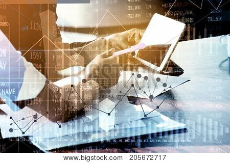 Double Exposure of Businesswoman with Investment advisor or secretary in office meeting use Digital Computer Tablet with Chart and Finance Figure as Financial Analyze Concept.