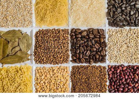 Grocery set: barley grits vermicelli rice sunflower seeds bay leafs buckwheat roasted coffee beans pearl barley figured macaroni dried peas freeze-dried instant coffee dried seeds of beans.