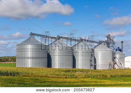 Five Round Metal Grain Elevator Bins