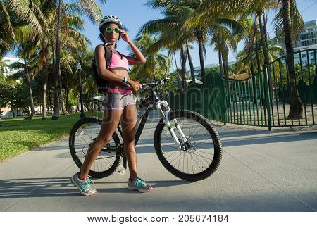 Fashionable young African woman and her mountain bike