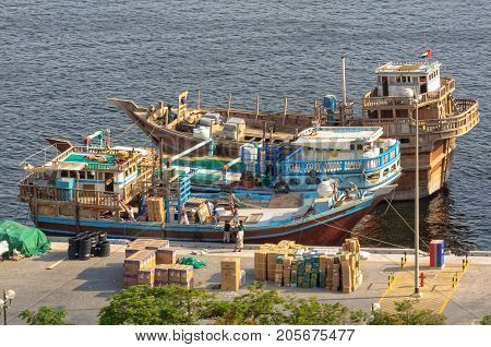 Wooden dhow cargo boats loaded with merchandise on Dubai Creek - United Arab Emirates, 4 July 2013