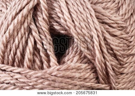 A super close up image of earth tone yarn