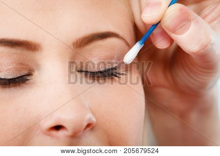 Woman Getting Her Makeup Done With Cotton Buds