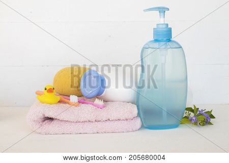 toothbrush of baby health care in oral cavity with shampoo head and body for baby on white