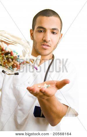 Doctor Spilling Many Pills