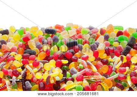 close up a background from colorful sweets of sugar candies. assortment candies view. colorful sweets isolated on white background