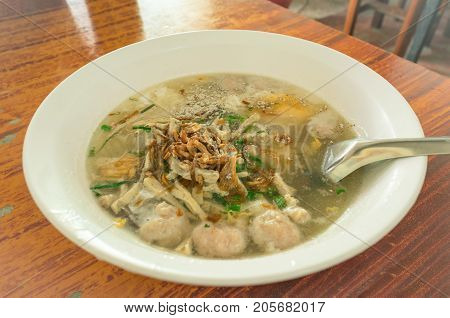 a noodles soup with ingredients on table
