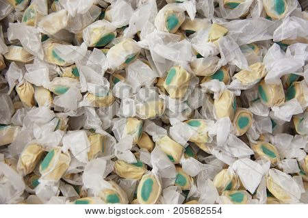 background of salt water taffy. mint chocolate candies