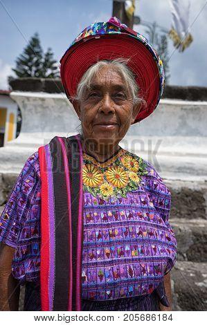 April 30 2016 Santiago de Atitlan Guatemala: elderly mayan woman in colourful traditional dress and hat