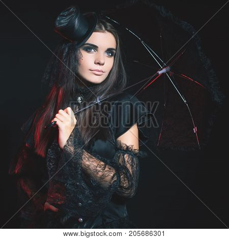 Entrance is limited to nightclub, dress code. Fashion young woman going to Halloween party 2017 Beautiful woman like doll with umbrella and hat. Moon, scary cemetery. Hallowen costumes