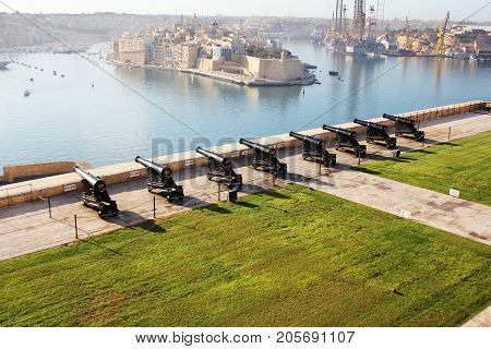 beautiful view from upper Barrakka Gardens of saluting battery and Grand Harbor of Valletta, Malta .