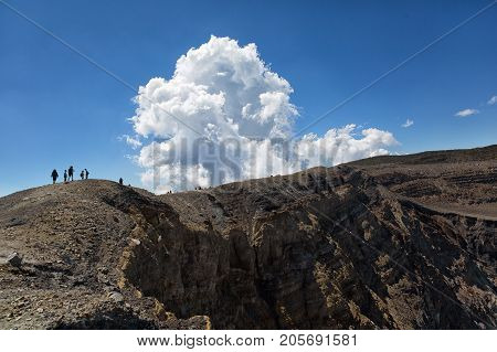 February 22 2015 Cerro Verde national park El Salvador: tourists walking on the edge of Santa Ana volcano crater