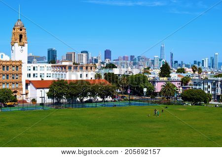 September 19, 2017 in San Francisco, CA:  View of the San Francisco Skyline from Dolores Park where people can relax and enjoy recreational activities while overlooking the city taken in San Francisco, CA