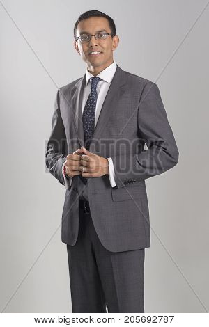 Portrait Of Man In Business Attire Twiddling Thumbs