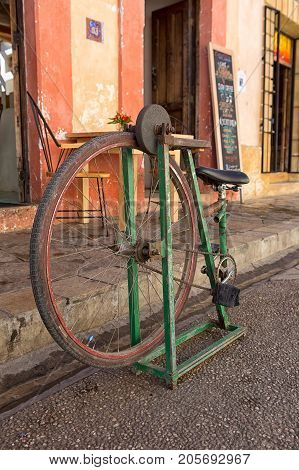 December 17 2014 San Cristobal de las Casas Mexico: foot propelled knife sharpener made of an old bycicle