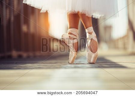 beautiful legs of female classic ballet dancer in pointe