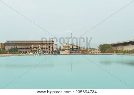 Recycled water on mining factory background. Recycling process.