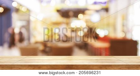Empty Wooden Table Top With Blur Coffeeshop Window Background, Panoramic Banner.