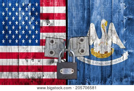 US and Louisiana flag on door with padlock
