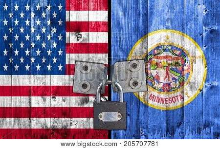 US and Minnesota flag on door with padlock
