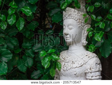 close up face on buddha head statue ; Selective focus face buddha statue.