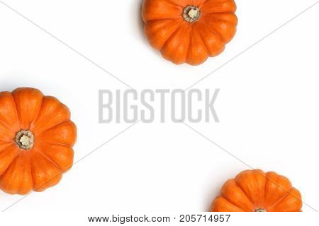 Autumn frame made of orange pumpkins isolated on white background. Fall, Halloween and Thanksgiving concept. Styled stock flat lay photography. Top view, empty space for your text.