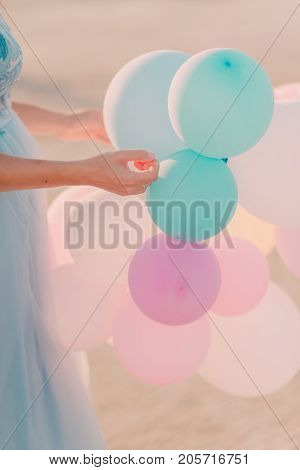 colorful balloons in the hands of a girl