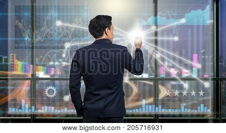 Back side of Businessman drawing the Technical information and trading graph over the virtual screen on the blurred of cityscape background out off windows Business financial concept, 3D illustration