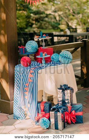 table decorated with paper balls and wooden houses