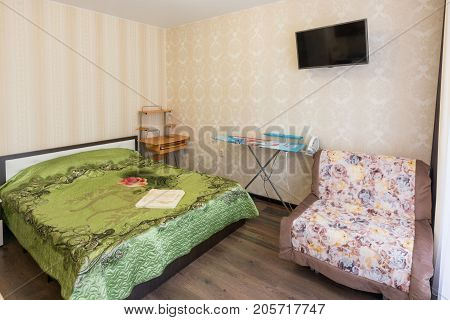 Interior Of A Bedroom With A Sofa In A One-room Apartment
