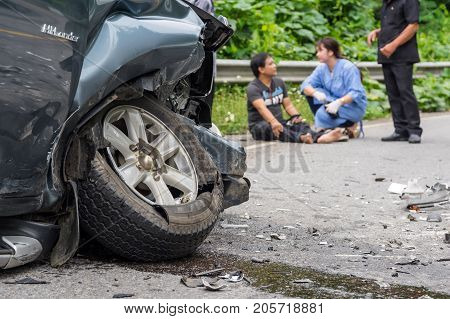 NAN THAILAND - OCT 25 : Car crash accident on the street of mountain over the photo blurred of Undefined casualty with nurse on the road on October 25 2016 in Nan province Thailand