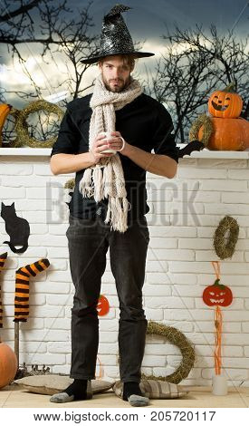 Halloween Man Holding Cup At Window With Autumn Trees