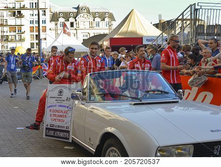 LE MANS, FRANCE - JUNE 16, 2017: Vitaly Petrov russian pilot racer with his team Oreca 07 Gibson 25 on a parade of pilots racing in Le mans, France