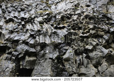 Volcanic basalt rock formations over the river
