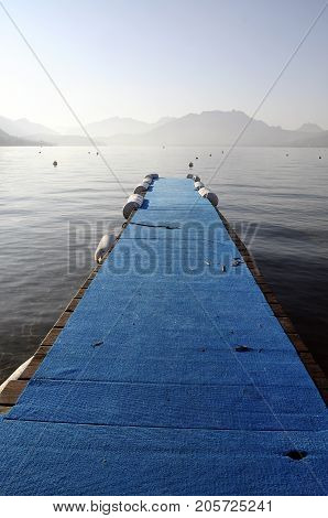 Annecy lake and mountains blue wooden pontoon Savoy France