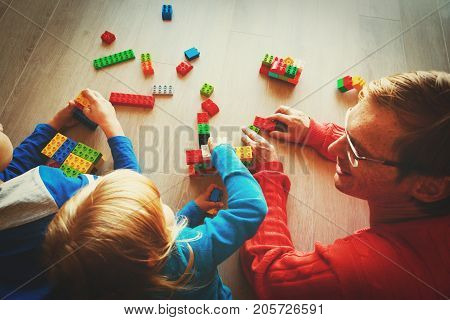 teacher and kids playing with plastic blocks, kids learning activities
