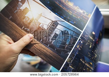 Photo Books Printing. Checking on Print Quality of the Photo Custom Digitally Printed Album.