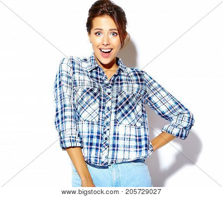 portrait of cheerful smiling fashion girl going crazy in casual hipster checkered shirt with no makeup on white background