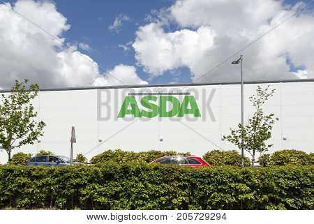 Swansea, UK: May 22, 2016: Side view of an Asda supermarket. Asda Stores Limited is an American-owned, British-founded supermarket retailer, headquartered in Leeds, West Yorkshire.
