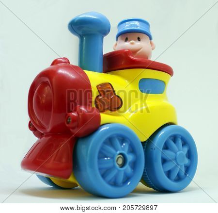 Colorful toy for child - plastic train with driver