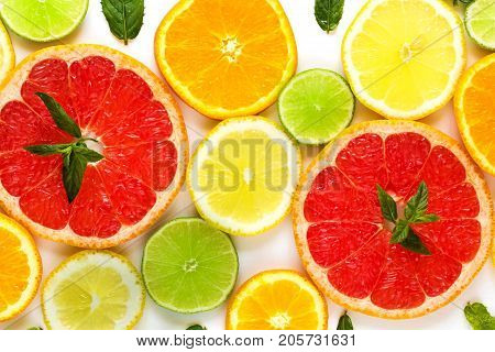 Citrus Food Pattern On White Background - Assorted Citrus Fruits With Mint Leaves. Isolated On White