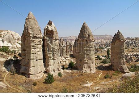 Love valley in Goreme village Turkey. Rural Cappadocia landscape. Stone houses in Goreme Cappadocia. Countryside lifestyle.