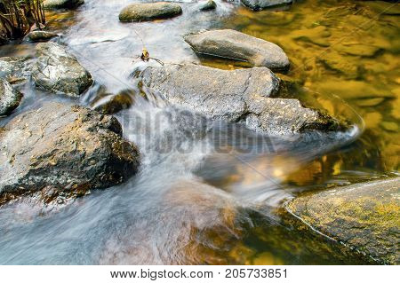Stones In Mountain River In Forest.
