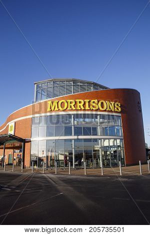 Swansea, UK: December 28, 2016: Main entrance to a Morrisons Superstore. Morrisons is the fourth largest chain of supermarkets in the United Kingdom, headquartered in Bradford, West Yorkshire, England.