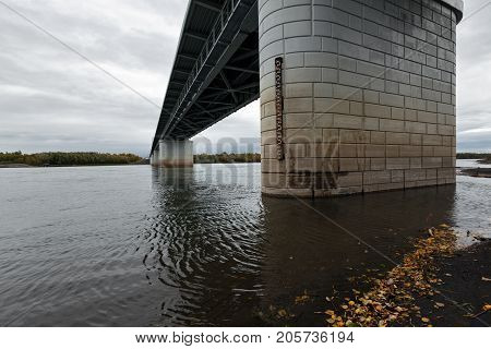 Bottom view of modern automobile bridge over Kamchatka River - largest longest and most flooded river on Kamchatka Peninsula. View of bridge on cloudy day. Eurasia Russian Far East Kamchatka Region