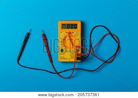 Digital electric tester on a blue background