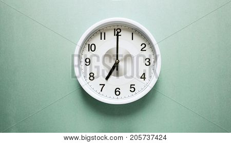 the clock arrow points to seven, seven o'clock